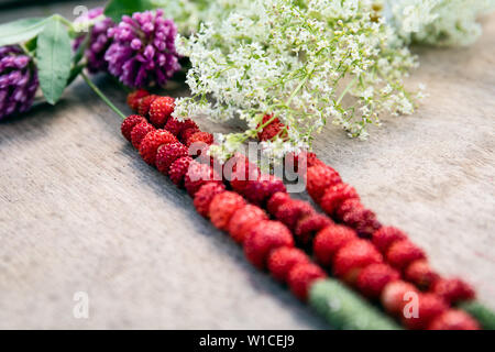 Forest strawberries on a wooden table - Stock Photo