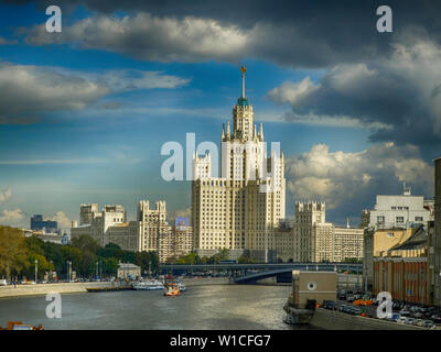 Kotelnicheskaya Embankment Building is one of seven stalinist skyscrapers also known as Seven Sisters. View from Bolshoy Moskvoretskiy Bridge. Stock Photo