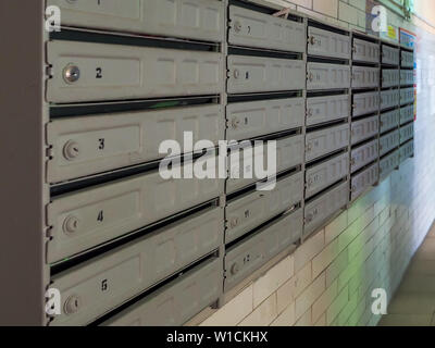 Block mailboxes in the entrance of an old apartment building. In anticipation of receipt of correspondence. - Stock Photo