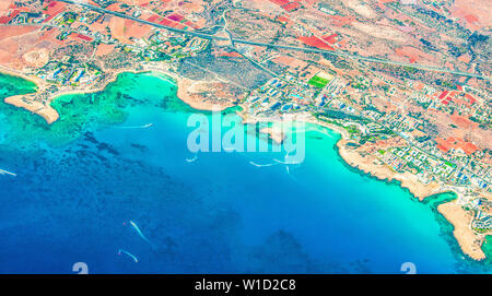 View from the plane to Ayia Napa - the best resort area of Cyprus, Nissi beach, the hotels, gulfs, parks. - Stock Photo