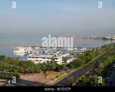 Manila, the Philippines - March 31, 2019: Downtown Manila with Roxas Boulevard, the Navy Headquarters and Manila Yacht Club in the foreground and the - Stock Photo