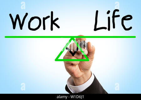 Closeup of man ticking inside scale drawing triangle as work and life balance concept on display with blue background - Stock Photo
