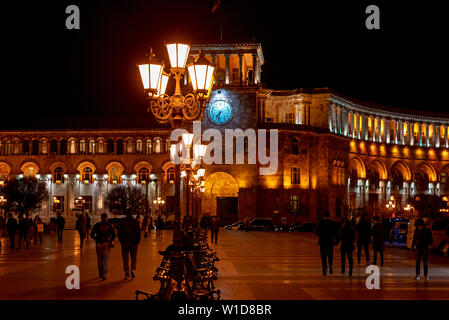 The Government of the Republic of Armenia and Central Post Office on Republic Square in Yerevan at night, Armenia - Stock Photo