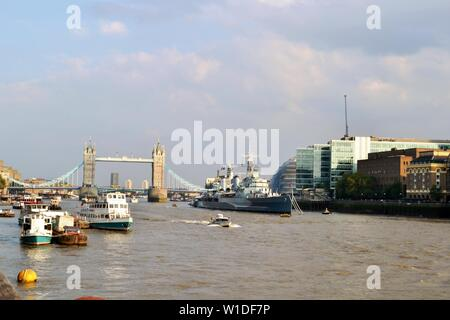 London/UK - September 7, 2014: Panoramic view to Tower bridge, Thames river, HMS Belfast in a sunny summer day. - Stock Photo
