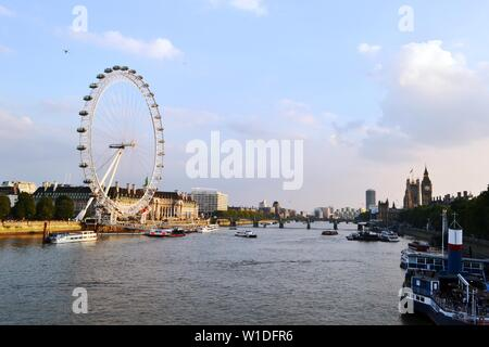 London/UK - September 7, 2014: Panoramic View to London Eye, Thames river, Houses of Parliament, Westminster bridge, Big Ben at sunset. - Stock Photo