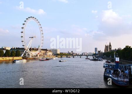London/UK - September 7, 2014: Panoramic View to London Eye, Thames river, Houses of Parliament, Westminster bridge, Big Ben at sunset. - Stock Photo