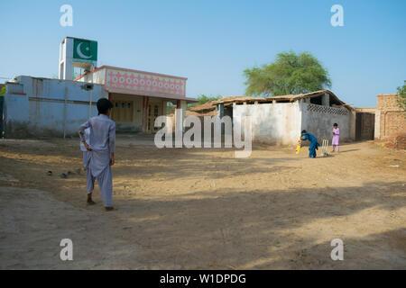 rahimyar khan,punjab,pakistan-july 1,2019:some local boys playing cricket in a village.batsman playing a shot. - Stock Photo