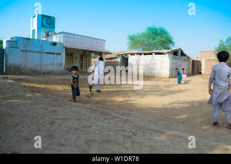 rahimyar khan,punjab,pakistan-july 1,2019:some local boys playing cricket in a village,batsman is trying to play a shot. - Stock Photo