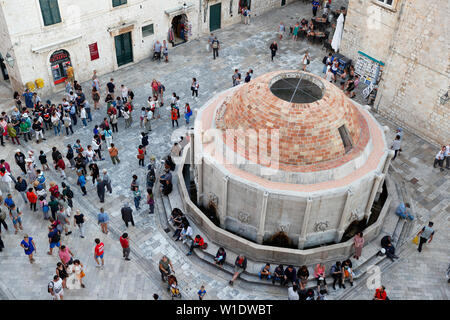 Onofrio's Fountain,view of fountain from city walls looking down with tourist visiting,Dubrovnik,Croatia - Stock Photo