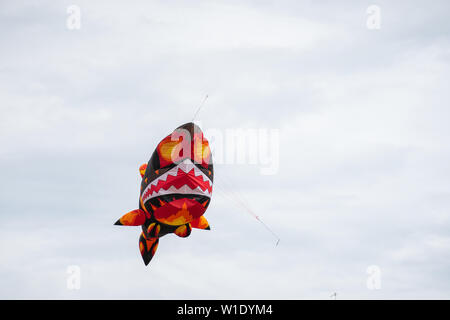 Bedford,Bedfordshire,UK,June 2,2019. Kites flying in the sky among the clouds.Bedford International Kite Festival. - Stock Photo