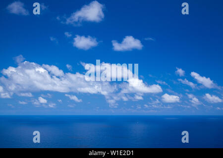 clouds over ocean, natural background of mostly sky - Stock Photo
