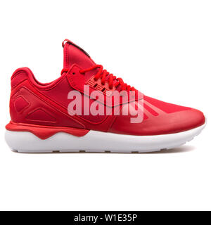 VIENNA, AUSTRIA - AUGUST 25, 2017: Adidas Tubular Runner red and white sneaker on white background. - Stock Photo