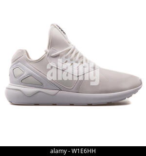 VIENNA, AUSTRIA - AUGUST 25, 2017: Adidas Tubular Runner white sneaker on white background. - Stock Photo