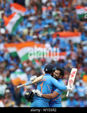 India's Rohit Sharma celebrates his century with team-mate KL Rahul during the ICC Cricket World Cup group stage match at Edgbaston, Birmingham. - Stock Photo