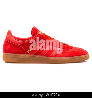 VIENNA, AUSTRIA - AUGUST 25, 2017: Adidas Spezial red sneaker on white background. - Stock Photo