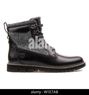 VIENNA, AUSTRIA - AUGUST 25, 2017: Timberland 6in black shoes on white background. - Stock Photo