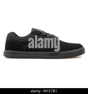 VIENNA, AUSTRIA - AUGUST 25, 2017: DC Tonik black sneaker on white background. - Stock Photo