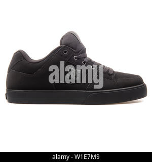 VIENNA, AUSTRIA - AUGUST 25, 2017: DC Pure black sneaker on white background. - Stock Photo