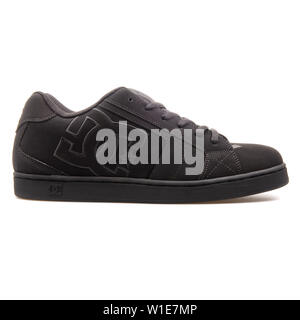 VIENNA, AUSTRIA - AUGUST 25, 2017: DC Net black sneaker on white background. - Stock Photo
