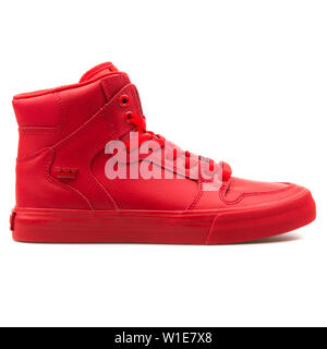 VIENNA, AUSTRIA - AUGUST 25, 2017: Supra Vaider red sneaker on white background. - Stock Photo