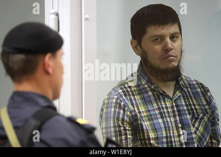 MOSCOW REGION, RUSSIA - JULY 2, 2019: GTA motorway gang member Khazratkhon Dodokhonov, charged with an attempted escape and attacking law enforcement officers, appears for a sentence hearing at the Moscow Regional Court. The gang robbed and murdered 17 drivers on highways in the Moscow and Kaluga Regions between 2012 and 2014. While on trial, Dodokhonov and four other gang members attacked convoy officers and tried to escape from the Moscow Regional Court; three were killed and one died in a hospital, Dodokhonov was the only one who survived. On August 9, 2018, Dodokhonov was given a life sent - Stock Photo