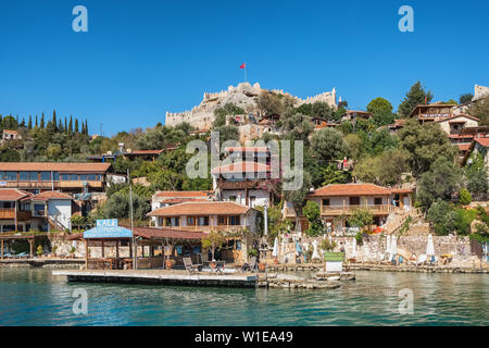 The village of Kalekoy and Simena Kalesi castle in Kale Ucagiz village, Antalya province, Turkey - Stock Photo