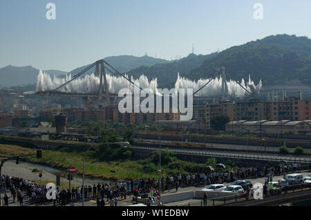 View of the Ponte Morandi Bridge remains during demolition and consequent collapse in Genoa, Italy on june 28, 2019 - Stock Photo