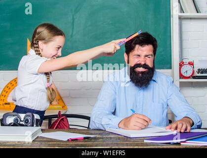 hate school. private lesson. back to school. Private teaching. small girl child with bearded teacher man in classroom. knowledge day. Home schooling. daughter study with father. Teachers day. - Stock Photo