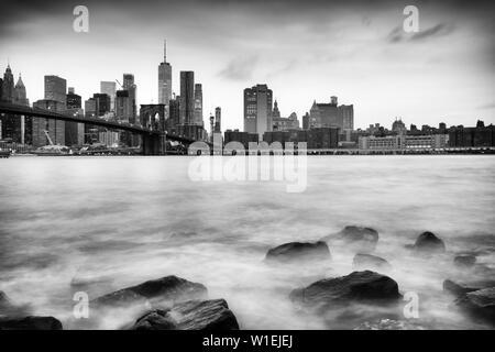 Brooklyn Bridge and Lower Manhattan skyline taken from Pebble Beach, New York City, New York, United States of America, North America - Stock Photo