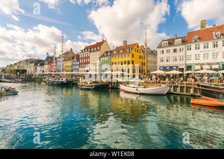 Nyhavn with old colourful houses and boats anchored in summer, Copenhagen, Denmark, Europe - Stock Photo
