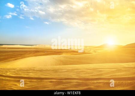 Desert landscape sand dunes at sunset near Qatar and Saudi Arabia border on Persian Gulf, Khor Al Udeid (Khawr al Udayd), Qatar, Middle East - Stock Photo