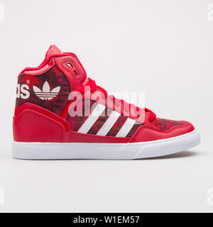 VIENNA, AUSTRIA - AUGUST 28, 2017: Adidas Extaball red sneaker on white background. - Stock Photo