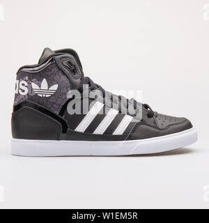 VIENNA, AUSTRIA - AUGUST 28, 2017: Adidas Extaball black sneaker on white background. - Stock Photo