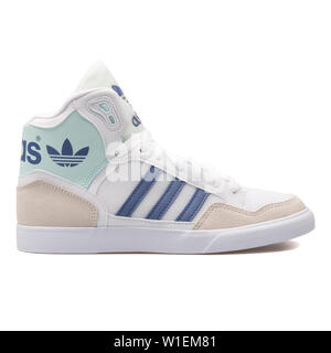 VIENNA, AUSTRIA - AUGUST 28, 2017: Adidas Extaball white sneaker on white background. - Stock Photo