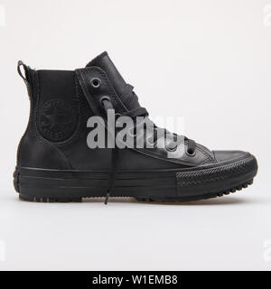 VIENNA, AUSTRIA - AUGUST 28, 2017: Converse Chuck Taylor All Star Chelsea Boot Rubber High black sneaker on white background. - Stock Photo