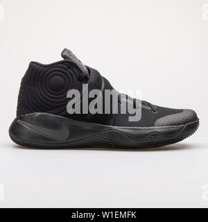 VIENNA, AUSTRIA - AUGUST 28, 2017: Nike Kyrie 2 black sneaker on white background. - Stock Photo