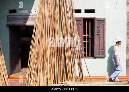 Vietnamese man at a house in the Xuan Lai Bamboo Village in the Red River Delta - Stock Photo