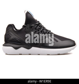 VIENNA, AUSTRIA - AUGUST 10, 2017: Adidas Tubular Runner black and white sneaker on white background. - Stock Photo