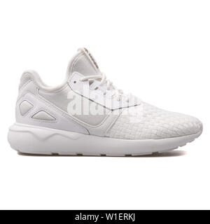 VIENNA, AUSTRIA - AUGUST 10, 2017: Adidas Tubular Runner white sneaker on white background. - Stock Photo