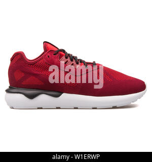 VIENNA, AUSTRIA - AUGUST 10, 2017: Adidas Tubular Runner Weave burgundy sneaker on white background. - Stock Photo