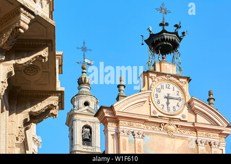 Saint Peter and Paul church clock and bell tower with automaton in a summer day, clear blue sky in Mondovi, Italy. - Stock Photo