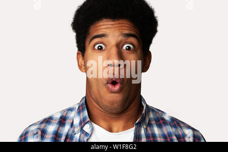 Horrified Guy Looking in Terror at Camera, Shocked Emotion - Stock Photo