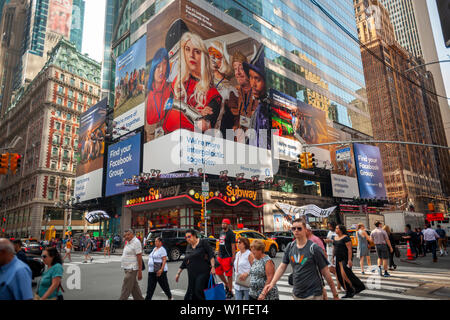 Facebook groups advertising in Times Square in New York on Friday, June 28, 2019. (© Richard B. Levine) - Stock Photo