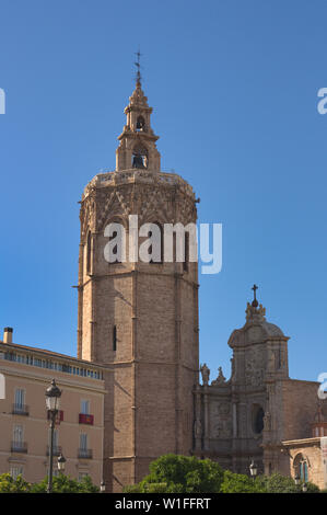 Tower of Miguelete and Puerta de los Hierros in the Cathedral of Valencia on a summer afternoon with clear blue skies - Stock Photo