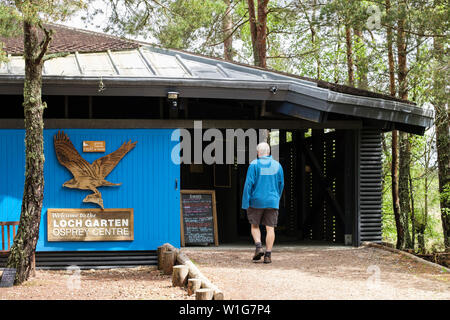 A visitor enters RSPB Loch Garten Osprey Centre in Abernethy Forest Nature Reserve in Cairngorms National Park. Strathspey Highland Scotland UK - Stock Photo