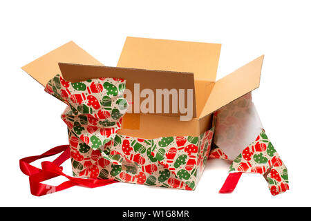 Beatifully wrapped present being unwrapped isolated on a white background. - Stock Photo