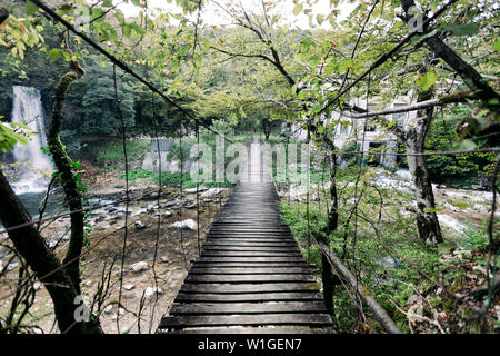 Suspension wooden bridge in the forest in Georgia - Stock Photo