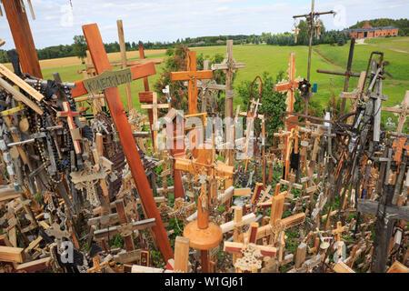 Hill of crosses (Kryžių kalnas), near Šiauliai in Lithuania - Stock Photo