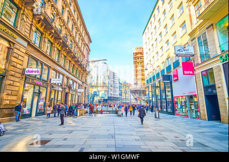 VIENNA, AUSTRIA - FEBRUARY 18, 2019: The central part of Vienna is a perfect place to make shopping and enjoy surrounding historical edifices and land - Stock Photo