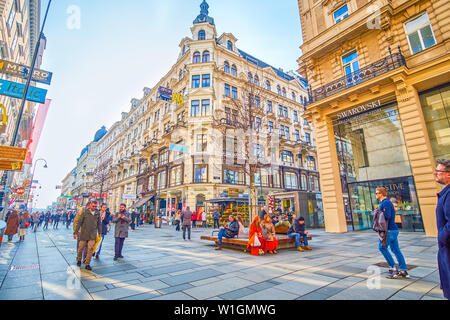 VIENNA, AUSTRIA - FEBRUARY 18, 2019: Karntner Strasse is one of the most notable shopping streets in old town with variety of boutiques and restaurant - Stock Photo